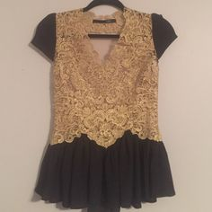 Delicate gold and black lace top NOT FOR LOVE OF LEMONS- tagged for exposure... Perfect for a night out! This top is 1-of-a-kind. Bought at a boutique in NYC, this top is adorned with a mesh see-through back, and beautiful v-neck. Peplum style. Zippers up the side  Pair with leggings or black jeans 💋💥 PRICE FIRM For Love and Lemons Tops Blouses