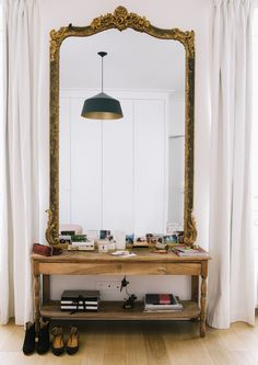 An extra large mirror or art piece makes a bold statement in the entry.