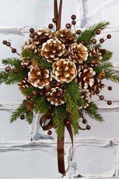 DIY Kissing Ball with Pine Cones - Crafts Unleashed Need an alternative to the traditional winter wreath? This beautiful pine cone DIY kissing ball is the perfect option - we'll show you how to make your own! Christmas Pine Cones, Noel Christmas, Rustic Christmas, Christmas Ornaments, Christmas Design, Primitive Christmas, Natural Christmas, Christmas Cactus, Christmas Lights