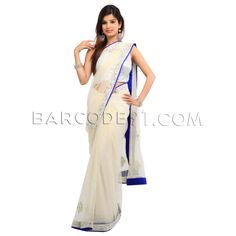 $332 Off white net saree is with pearl embroidery.It comes with red raw silk blouse piece.Slight variation is possible in color.