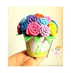 Flores de eva - passo a passo em :  http://www.grzero.com.br/arranjo-de-flores-de-eva-passo-passo/