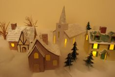 A miniature Christmas village made of paper