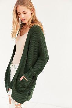 BDG Parker Cardigan Sweater $59  Soft knit, front pockets, ribbed knit hem From UO's original BDG line https://api.shopstyle.com/action/apiVisitRetailer?id=481127426&pid=uid841-37799971-81