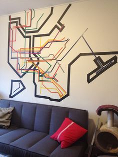 Electrical tape mural of the NYC subway system -- I would never do it, but it is very interesting!!!! jls