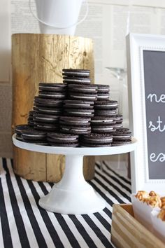 Adorable Stack of Oreos Photography: Laura Derksen - www.arrowandlacedesigns.com  Read More: http://www.stylemepretty.com/living/2014/10/31/black-and-white-1st-birthday/