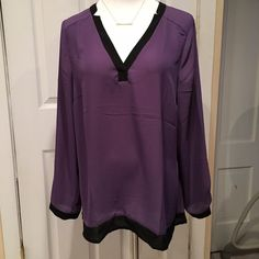 """✨Purple Blouse✨ Beautiful grape-purple blouse with black trim. Long sleeve with button at cuff. 100% Polyester. The size is not noted but measurements fit a 1X. Bust is 44"""" and Hip is 48"""". Gorgeous and lightweight! Excellent Condition! 💖🎀🛍 Christopher & Banks Tops Blouses"""