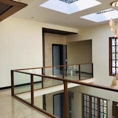 nataraja residential modern living room by geometrixs architects & engineers modern Staircase Design Modern, Modern Exterior House Designs, Modern House Design, Staircase Ideas, Railing Design, Door Design, Exterior Design, Pooja Room Design, Interior Design Living Room