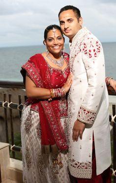 Red and white Indian bridal lehnga and shervani - Cancun Destination Indian Wedding via IndianWeddingSite.com