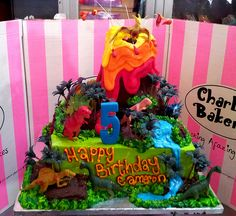 Square Vanilla pound cake iced in green butter icing, with 3D Wicked Chocolate Volcano on top, piped jungle scene with toy dinosaurs (toys provided by customer) | Flickr - Photo Sharing!