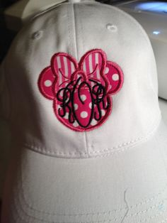 Minnie Mouse with a bow and infinity font
