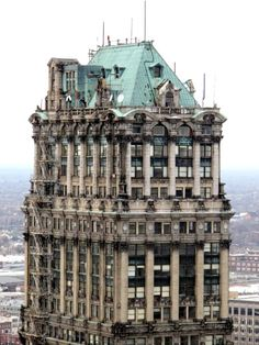 The Book Tower, as seen from the David Stott Building. Some called architect Louis Kamper a cake decorator because of all the stuff he crammed onto his buildings. Abandoned Detroit, Abandoned Houses, Abandoned Places, State Of Michigan, Detroit Michigan, Detroit Downtown, Detroit Skyline, Architecture Design, Amazing Architecture