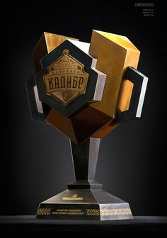 Main Caliber Trophy on Behance Basketball Trophies, Trophies And Medals, Acrylic Trophy, Trophy Plaques, Office Wall Design, Trophy Cup, Trophy Design, Stage Design, Typography Logo