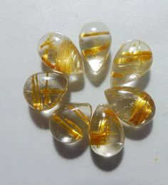 Listing Description Item Stone Name :- Natural Golden Rutilated Quartz Carat (WT):- 13 Carat Quantity :- 1 Piece Pcs Lot) Shape:- Pear Shape Smooth Plain Cabochon Gemstone Type :- Natural (Untreated and Unheated) Measurements:- MM Quality:-AAA++ Golden Rutilated Quartz, Stone Names, Pear Shaped, 1 Piece, Shapes, Gemstones, Natural, Top, Gems