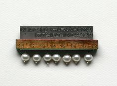 Lantern Series Brooch, found objects, pearls by  Jack Cunningham