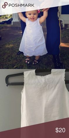 Linen scallop edged dress Beautiful and simple white scallop edge dress. White linen w 2 snap closure at the top back, scalloped edges overlap to cover the back. No stains/discoloration. Only worn x2. No size tag pictured on 10 month old, would still fit well at 14 months. Dresses