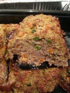 Homemade dog food. My babies devoured it! Ground beef, rice, pumpkin, peas, carrots, sweet potato, and eggs.