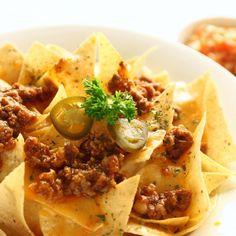 A simple and tasty recipe for home made beef and cheese topped nachos. Serve with salsa and sour cream.. Home Style Nachos  Recipe from Grandmothers Kitchen.