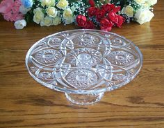 This is a nice tall, heavy glass, vintage cake stand. It measures almost 12 in diameter and stands a nice 5 high. The pattern is very beautiful with several different complimentary motifs. Condition: It has a tiny area about 1/4 long on the underside (see last picture) that almost looks like frosted glass or sticker residue that I was not able to remove. It is in otherwise, beautiful condition. Packaged weight is 6 lbs. shipped in a 14 x 14 x 10 box. Its a stunning piece that will displ...