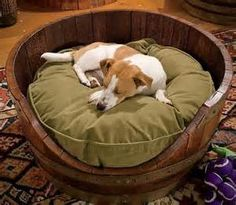 Dog Bed- Saw whisky barrel at Lowes Home Improvement. Good project for my husband.