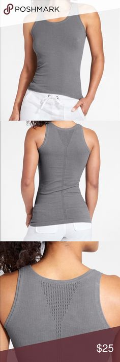Athleta Pura Tank In Silver Bells Gray, sz S. Athleta Pura Tank In Silver Bells Gray, sz S.  Fitted so could fit an xs. Lightly worn and in good condition.  Organic Cotton SEAMLESS. Beyond-soft, chafe-free fabric stretches with your every move BREATHABLE. Sweat can travel through the fabric so it can evaporate on the surface ORGANIC COTTON. Naturally breathable fabric feels light on your conscience IT FEELS: Lightweight, unspeakably comfortable Athleta Tops Tank Tops