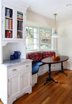 small traditional kitchen nook built in bench seat with red fabrics back dark wood table in oval shape medium toned wood floors white kitchen set Banquette Seating In Kitchen, Kitchen Benches, Timber Kitchen, Kitchen Dining, Built In Seating, Built In Bench, Bench Seat, Curved Bench, Small Bench