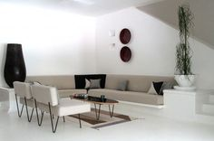The mid-century modern furniture offers a contrast to the bold Mexican art pieces