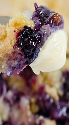 The Most Delicious Blueberry Dump Cake Ever- using fresh summer blueberries, this cake is the best! @momof2lilones
