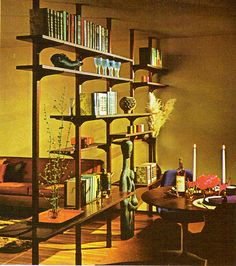 More floating shelves. Love the concept of creating two separate spaces without using a wall.