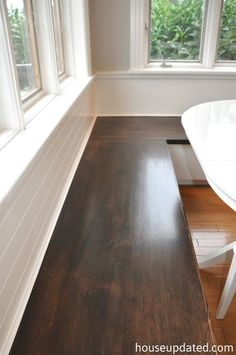 """Storage underneath?? Kitchen banquette -- stained seat (easy to slide in, easy to clean), """"paneled"""" back."""