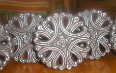 Medium Drapery Medallions by Metropolis Iron, Inc.  http://metroiron.net/item-10051-3-34-diameter/