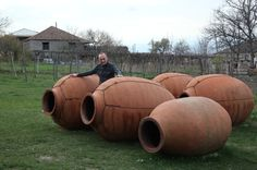This winemaker makes wine in clay vessels called qvevri, which he buries underground and fills with white grapes. There are no barrels, vats or monitoring systems. When the wine comes out, it's an orange color. Distilling Equipment, Wine Making Process, Orange Wine, Porch And Balcony, Types Of Wine, Contemporary Ceramics, Clay Pots, Ancient Art, Ancient History