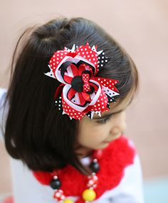 This polka dot hair bow is too cute! Lots of polka dot ribbon in red, black, and white loops around a grosgrain ribbon mouse face (with its own tiny bow!). There's a double pronged alligator clip back