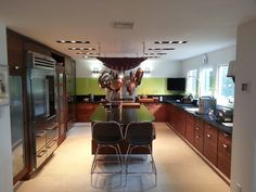 Here's a job we just completed in Hewlett Harbor, NY. A walnut wood kitchen in modern splendor.