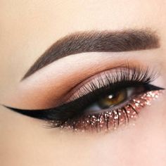 Pinkish peachy colour with gold and black eyeliner