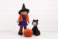 """""""This is Halloween, this is Halloween, Halloween! Halloween! Halloween! Halloween! In this town we call home Everyone hail to the pumpkin song""""        Conjure this adorably spooky toy set by the spectacular Amanda Berry in the ever-soft Studio DK.    Blair the Witch is 31cm tall (including her hat) Jack O'Lantern is 9cm tall (Including his stalk) Dera-Mog is 18cm tall (Including her ears)    This product contains all of the yarn required to knit these 3 characters, along with a..."""