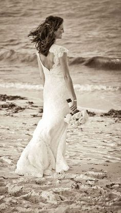 Barrie wears the 'Jessica' lace gown by Modern Trousseau.