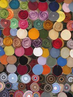 A colorful collection of yarmulkes for sale.