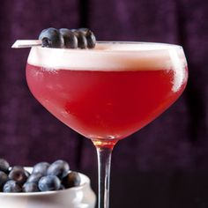 Blue Velvet Cocktail Martini Recipe: Blueberry Vodka, Creme de Cassis, Aromatic Bitters, Simple Syrup, a splash of sparkling Moscato, fresh blueberries and lime juice.