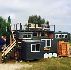 This is one couple's mostly-DIY tiny house on wheels with a rooftop deck, outdoor shower, and an indoor bath tub! It's Sean and Angie Johnson's (Instagram) tiny home. They named i…