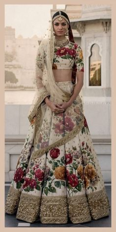 Get yourself dressed up with the latest lehenga designs online. Explore the collection that HappyShappy have. Select your favourite from the wide range of lehenga designs Sabyasachi Lehenga Bridal, Floral Lehenga, Indian Bridal Lehenga, Indian Bridal Wear, Indian Wedding Outfits, Bridal Outfits, Indian Wear, Indian Outfits, Indian Saris
