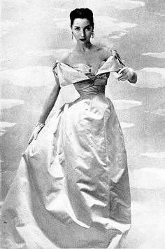 Renee Breton wearing an evening gown by Jacques Fath as seen in Harper's Bazaar, April 1954
