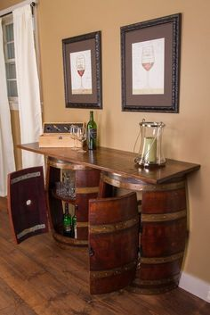 Double Half Barrel Bar - Wall Mount  This amazing bar gives you the appeal of two real whole retired wine barrels in a smart space saving design. Use it as a bar or as a sideboard. It offers ample storage with two half wine barrel cabinets with one interior shelf each and a bar top made from with a distressed finish reclaimed wood.