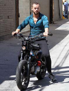 Artem having a ride on Sasha's bike at rehearsal studios 16/4/15 - credit: Phamous Fotos via DMOnline