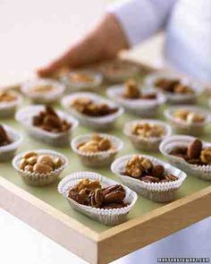 """As a late-night snack (or served during cocktail hour), pass candy cups of sweet-and-savory nuts for a delicious, no-fuss treat. Each paper """"bowl"""" holds just the right snack-size amount. Our homemade mix is served alongside cups of purchased Marcona almonds."""