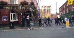 Video footage filmed by an eyewitness at the scene shows a group of around 12 men approaching the pub