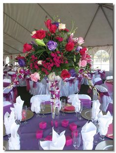 Quinceanera table Decoration Ideas. My favorite color is purple and I think it looks great on the tables.