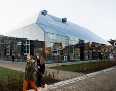 MVRDV: Glass farm in the Netherlands. Steel and glass structure with a scaled up image of an archetypal farm printed to the backside of the glass.