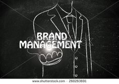 business man holding the word Brand Management