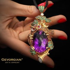 """Eagle-Owl"" Pendant by GEVORGIAN. A stylized pendant portrays a wise eagle-owl holding a large Amethyst in its claws, the stone of creative people, pioneers.  The stone motivates people to search for harmony in them and in the world. It is no accident that a prophetic bird was chosen as the stone keeper: the wise eagle-owl will help to explain feelings and images cast by the perspicacious stone."