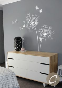 This wall decal with blowing dandelions and butterflys will freshen up any room. Especially looks great in nursery and kids playroom spaces. Wall decals offer an easy and affordable solution to take on those blank walls without the need of hanging wallpaper or painting. Temporary vinyl wall decal is ideal for apartment renters or anyone who loves to decorate.  This decal comes in standard size: - 71 (180 cm) tall x 55 (140 cm) Custom size available!  SET INCLUDES  Dandelion vinyl decal 5…